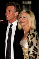 "John Easterling and Olivia Newton-John attending the red carpet gala premier for ""Score: A Hockey Musical"" at the 2010 Toronto International Film Festival (TIFF)"